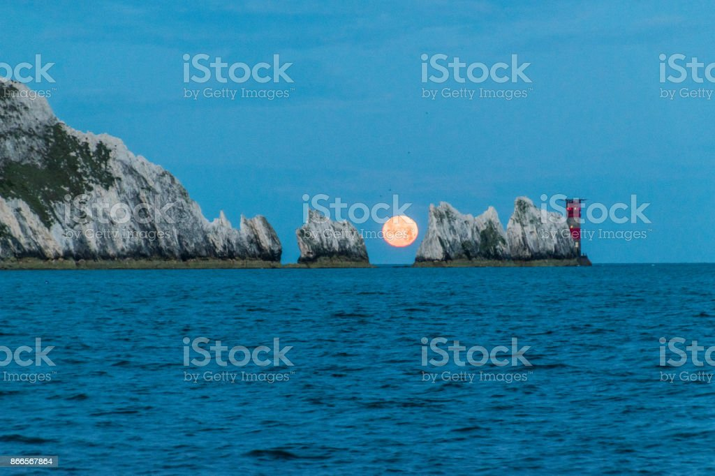 Moonset behind the Needles stock photo