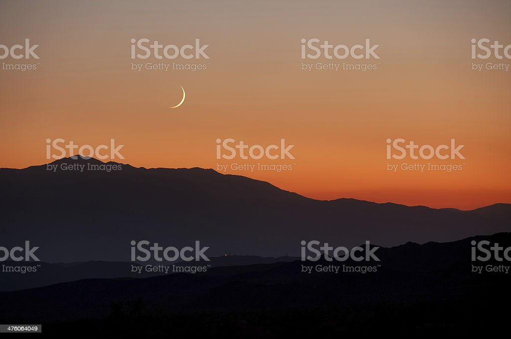 Moonset over California mountains stock photo