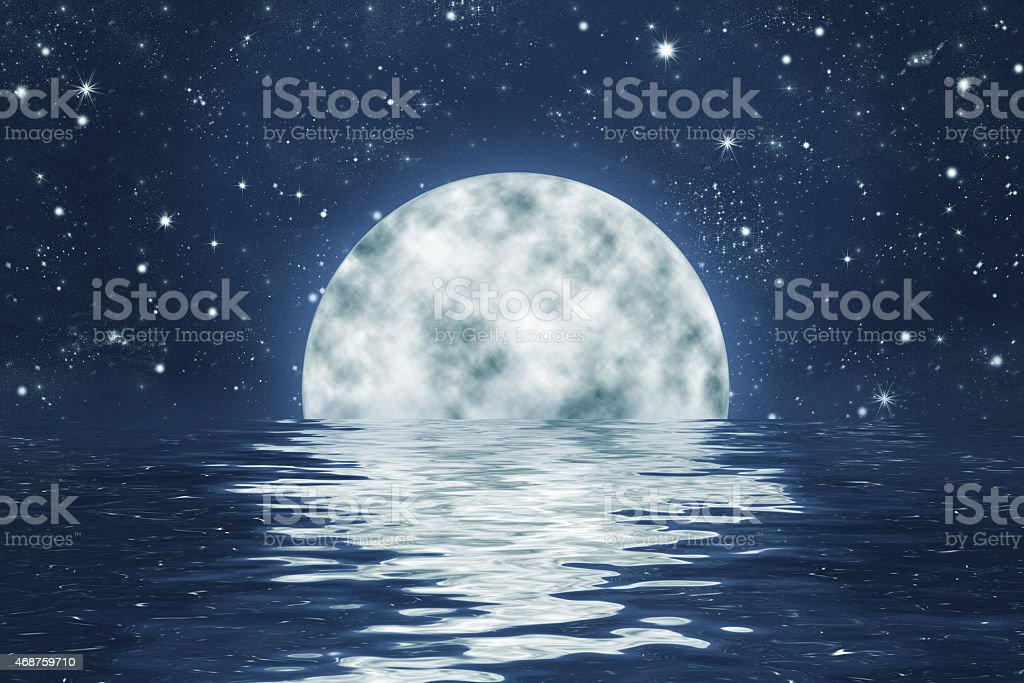 moonset over water with night sky and stars stock photo