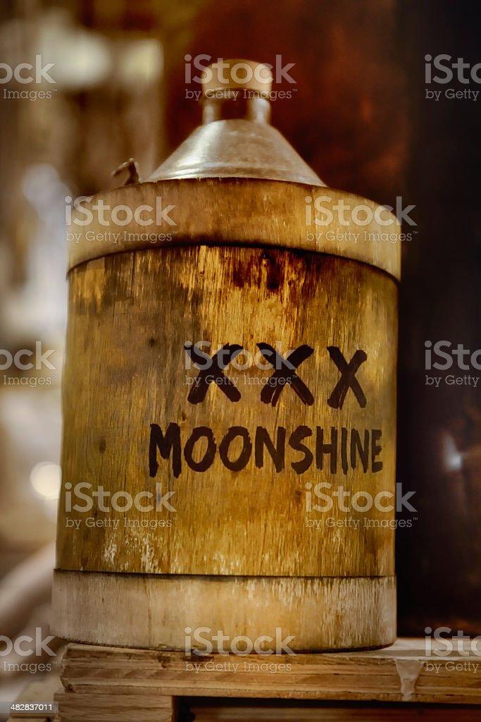 Moonshine jug, wood barrel, vintage style stock photo