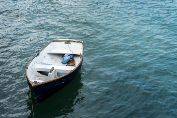 Moored Boat View of a moored boat sailing dinghy stock pictures, royalty-free photos & images