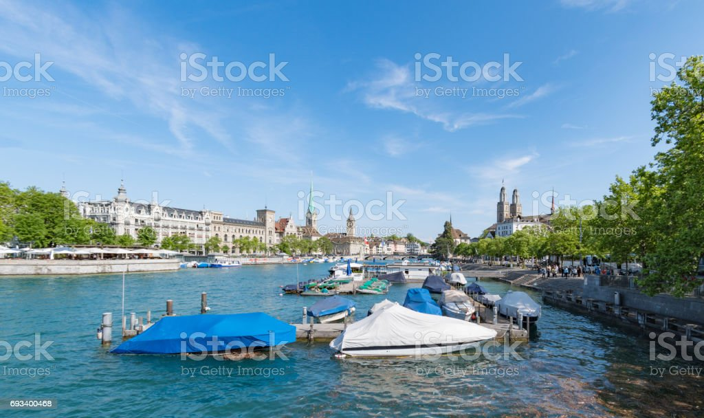 Moored boats and skyline of Zurich stock photo
