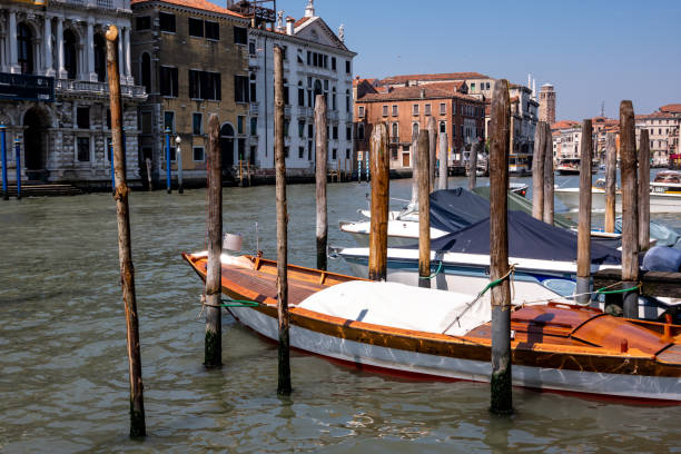 Moored boats in a Venice canal stock photo
