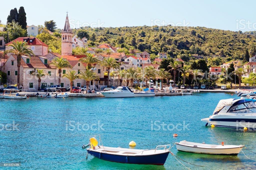Moored boats in the harbor of a small town Splitska - Croatia, island Brac stock photo