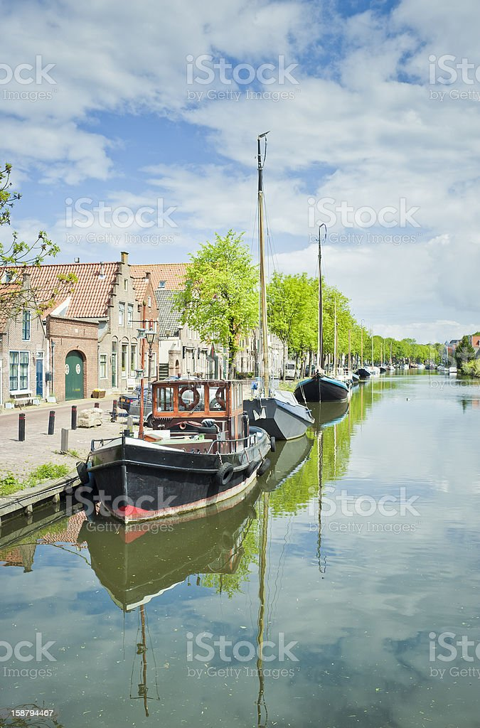 Moored Boats On The Canal In Edam, Netherlands stock photo