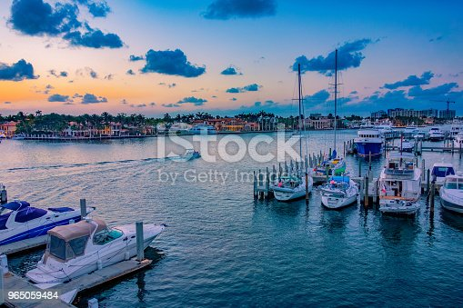 moored boats, sunset over water, pastel colors