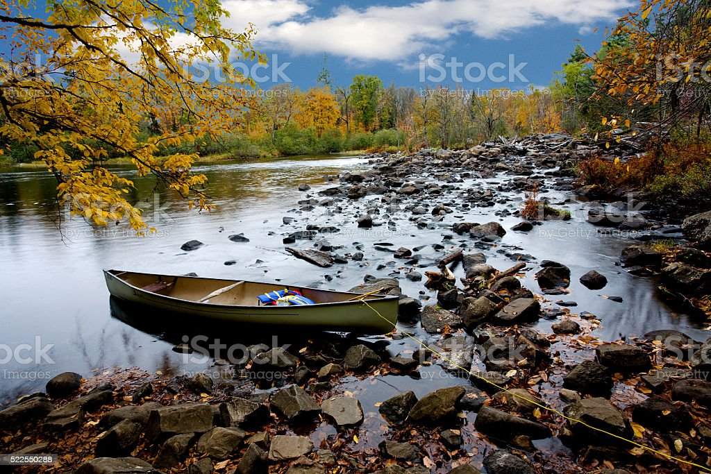 Moored Canoe in a Northern Stream stock photo