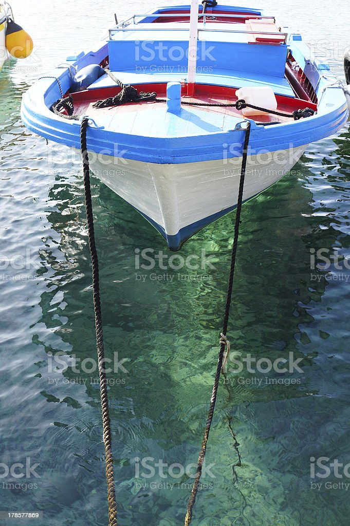 Moored fishing boat on crystalline sea royalty-free stock photo