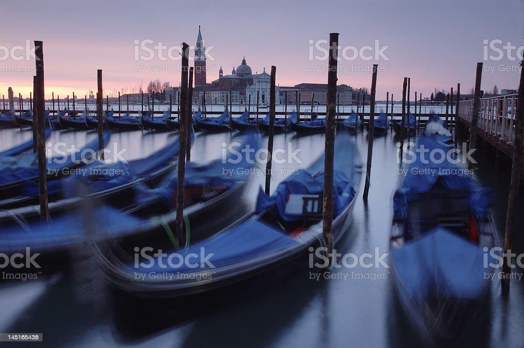 Moored Gondolas in Venice, Italy, San Giorgio Maggiore church royalty-free stock photo