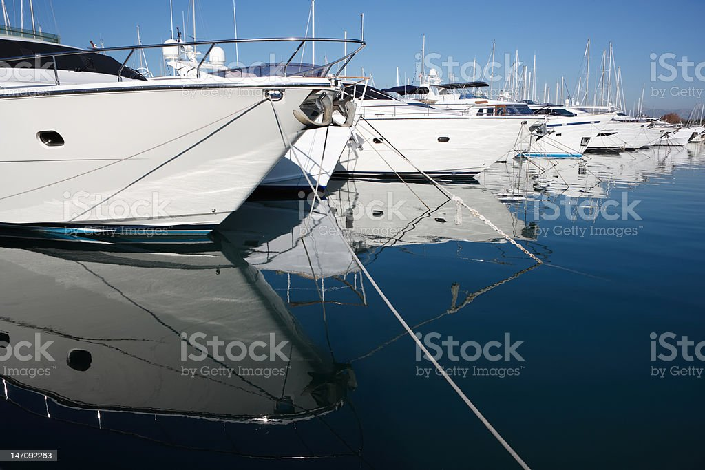 moored luxury yachts at mediterranean harbor stock photo