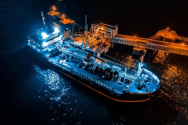 moored oil tanker port - drone shipyard night imagens e fotografias de stock