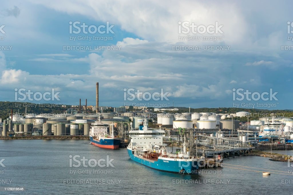 Moored oil tankers unloading oil at an oil terminal in the harbor of...
