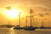 Moored sailboats in a St. Martin Harbor at sunset II.