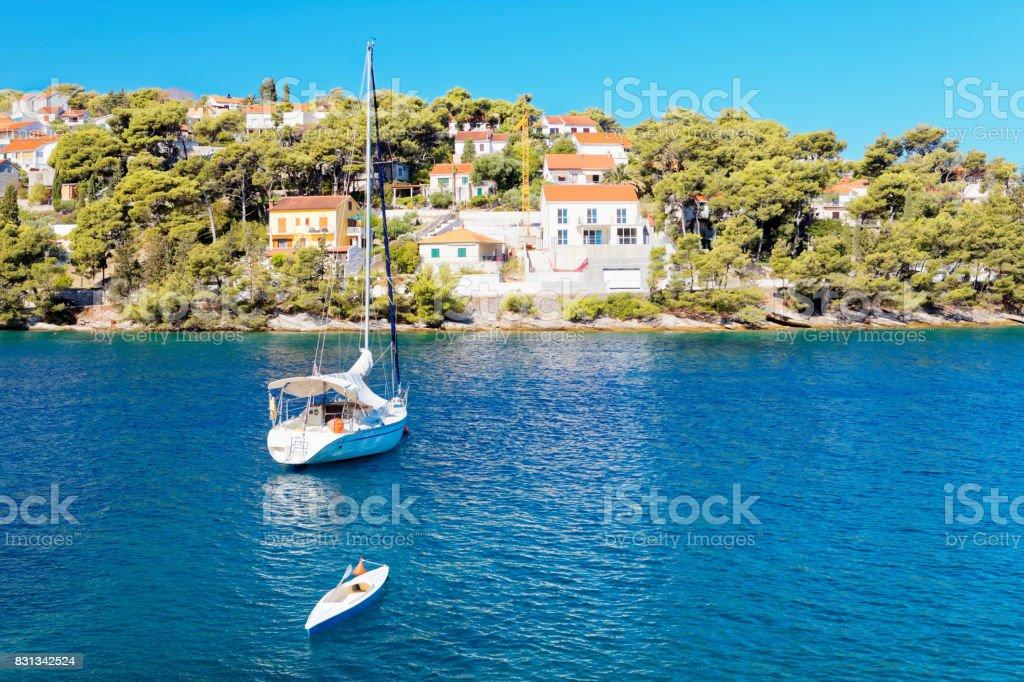 Moored yatch in the harbor of a small town Splitska - Croatia, island Brac stock photo