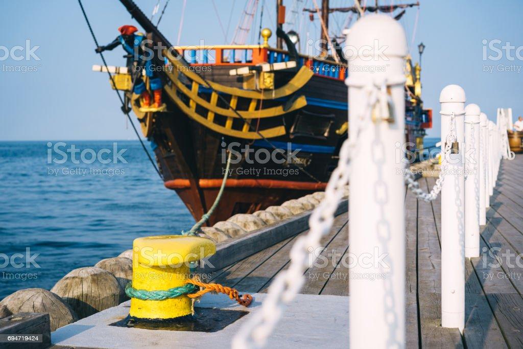 Mooring bollard on a pier stock photo