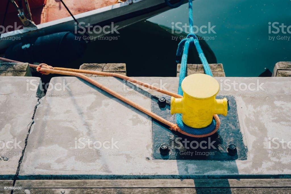 Mooring bollard on a wooden pier stock photo