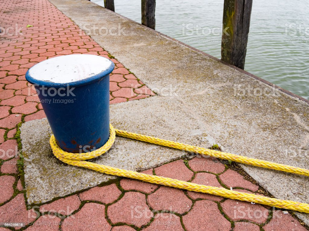 Mooring Bollard with Rope on pier. Lake Balaton. Keszthely, Hungary. stock photo