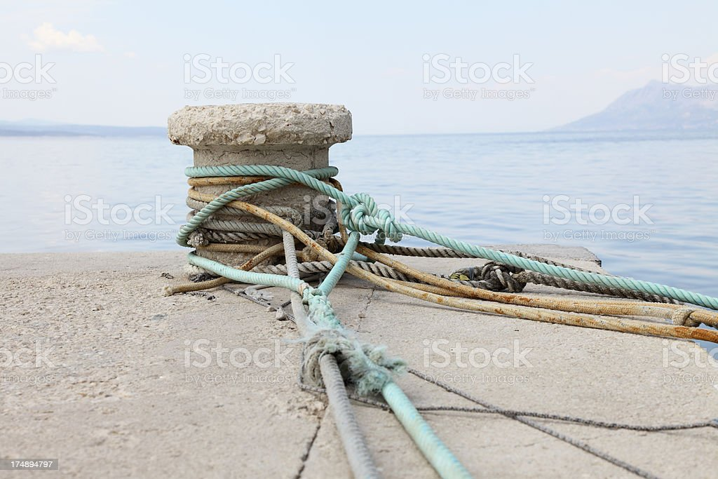mooring harbour  bollards and mediterranean ocean with  ropes  Croatia royalty-free stock photo
