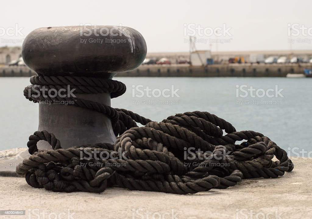 Mooring line on a bollard in Tarifa port in Spain. stock photo