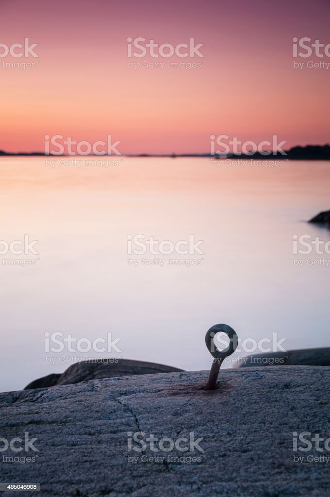 Mooring loop at Swedish west coast in sunset stock photo