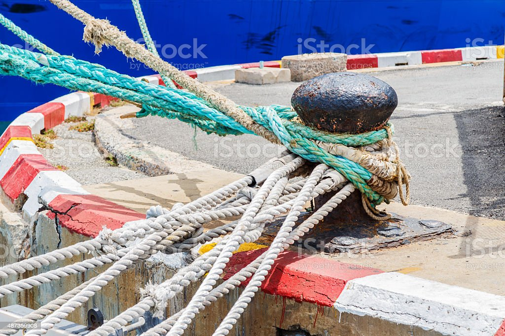 Mooring poles braided with mooring ropes stock photo