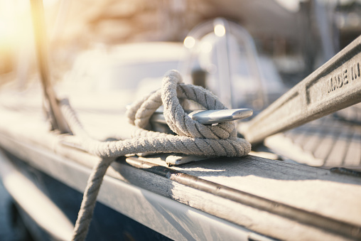 Mooring rope and bollard at the touristic harbor: vacations and yatching concept