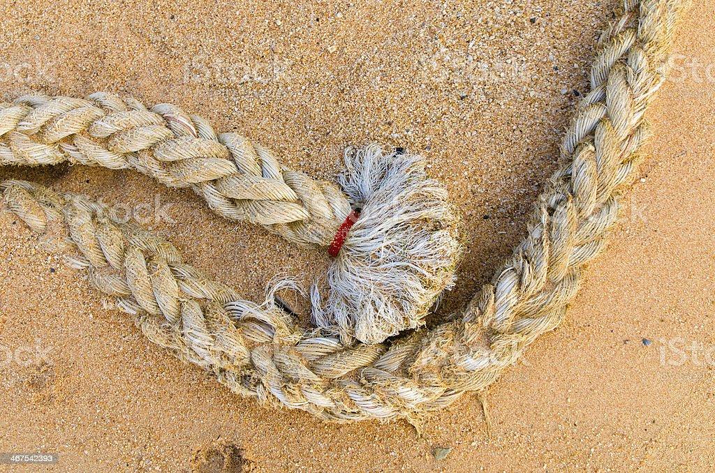Mooring rope on sand stock photo