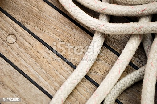 Mooring ropes laying on a ship deck