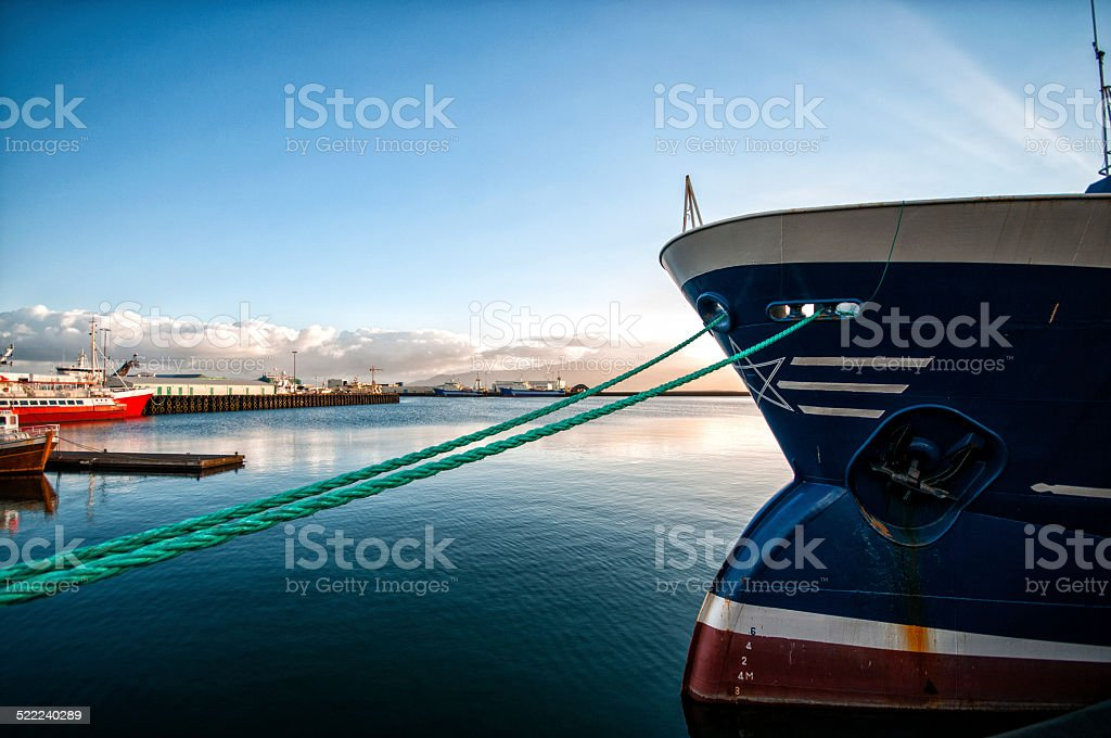 Mooring ropes from bow of a boat in Reykjavík harbour stock photo