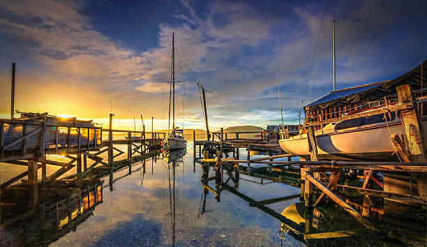 Moorings And Jetties At Port Chalmers During Sunrise, Dunedin stock photo