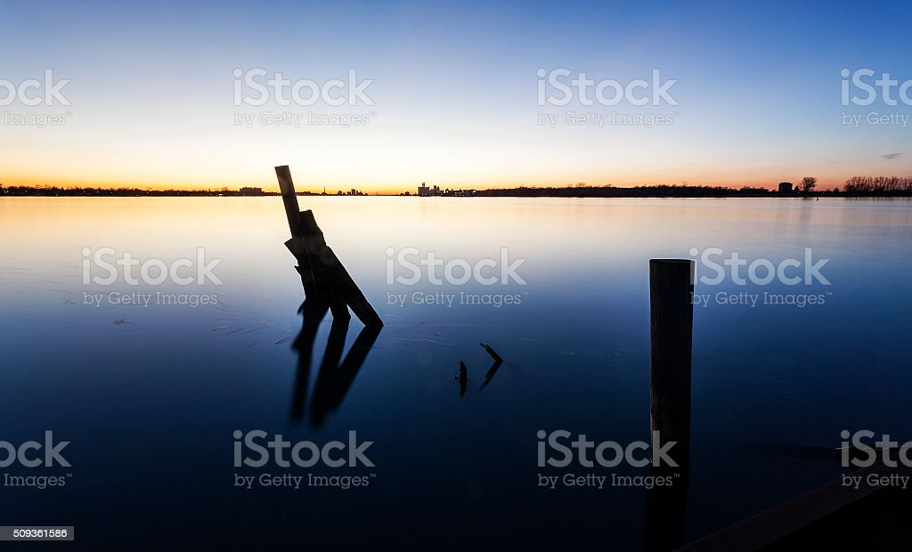 Moorings in Still Water on a Sunset Evening stock photo