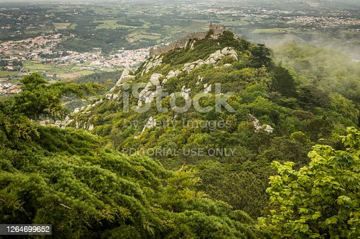 View of the Portuguese town of Sintra with the Moorish fortress or Castelo dos Mouros on the hilltop above the city.