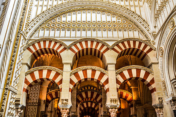 Moorish style arches within the Mezquita in Cordoba, Spain Moorish style arches within the Mezquita in Cordoba, Spain cordoba mosque stock pictures, royalty-free photos & images