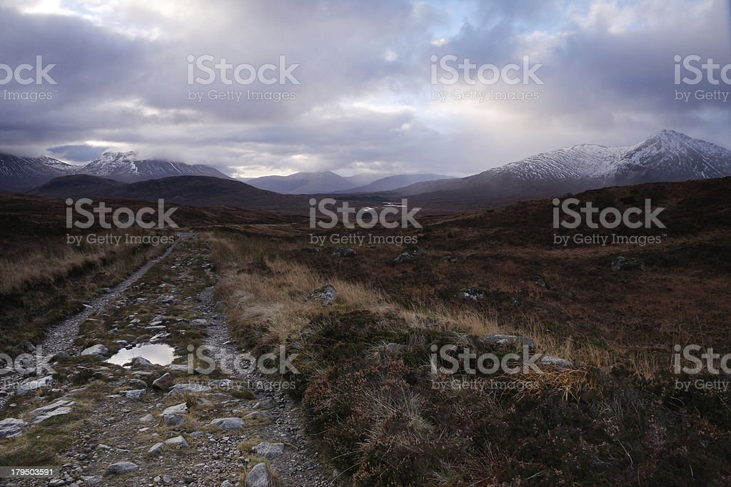 Moorland track leading to distant hills royalty-free stock photo
