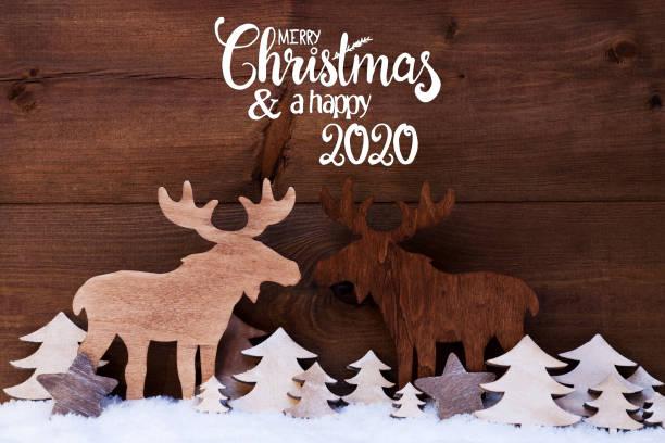 Elch, Holzbaum, Schnee, Frohe Weihnachten und glücklich 2020 – Foto