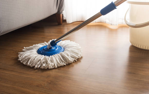 Mop cleaning on wooden floor Mop cleaning on wooden floor in house mop stock pictures, royalty-free photos & images