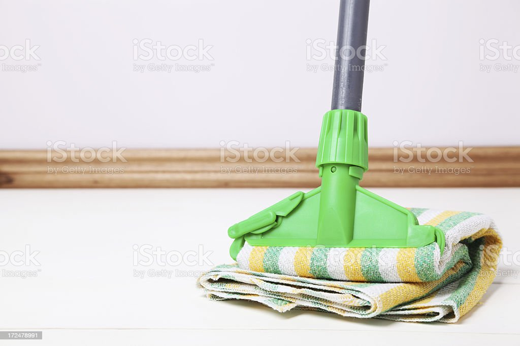 Mop on wood floor royalty-free stock photo