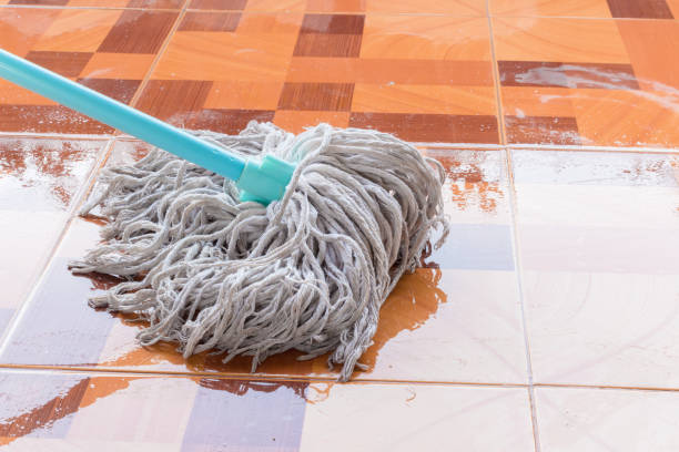 Mop the tile floor in home Mop the tile floor in home mop stock pictures, royalty-free photos & images