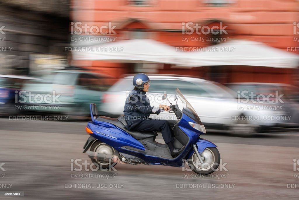 Moped Driver in Italy stock photo