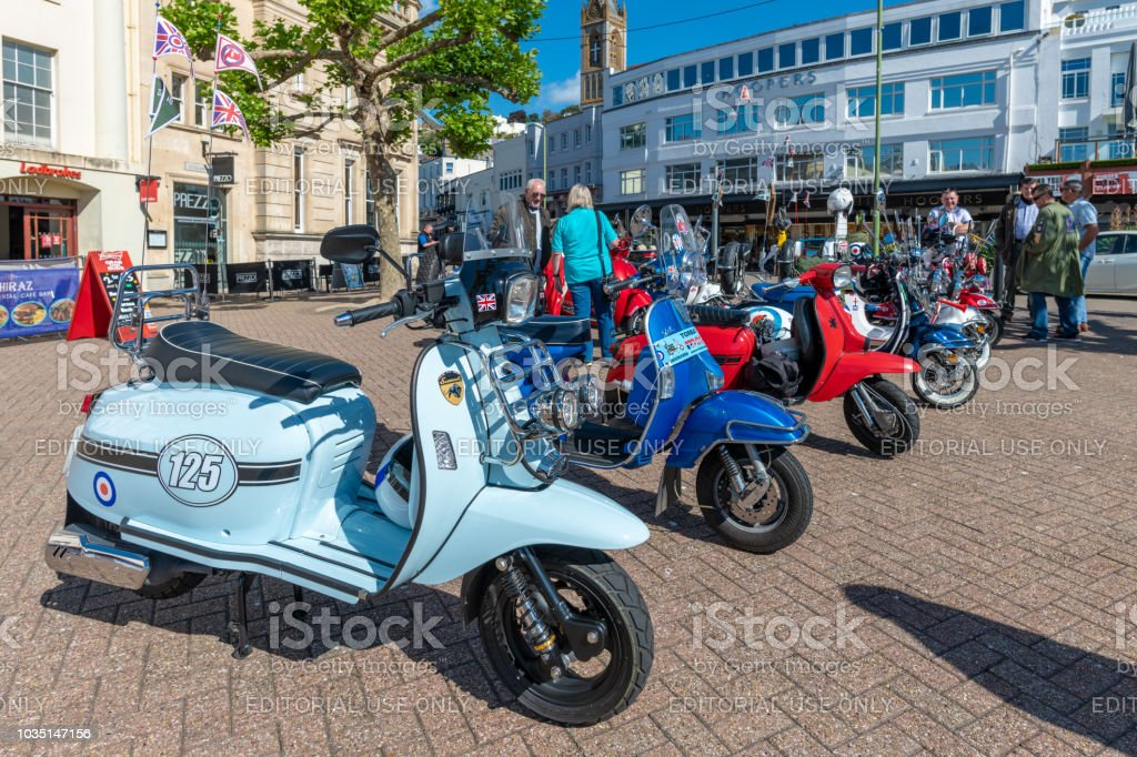Moped scooters parked in Torquay, Devon stock photo