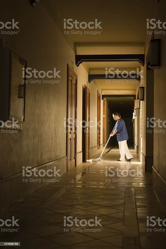 Mopping a hallway royalty-free stock photo