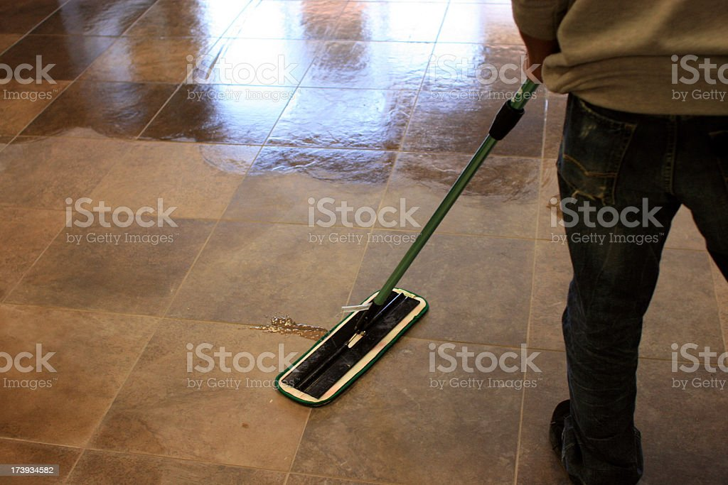 Mopping a Tile Floor royalty-free stock photo