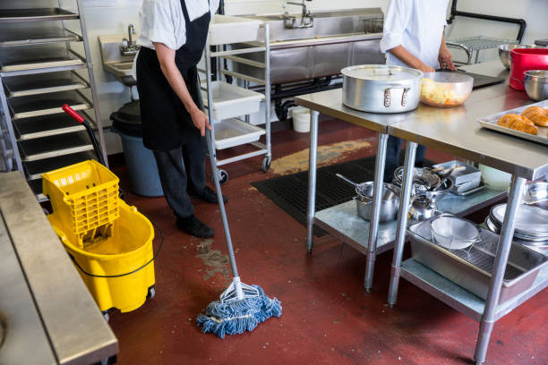 Mopping the floor in a commercial kitchen stock photo