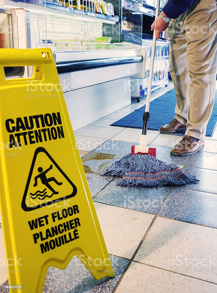 Mopping the floor in a store royalty-free stock photo