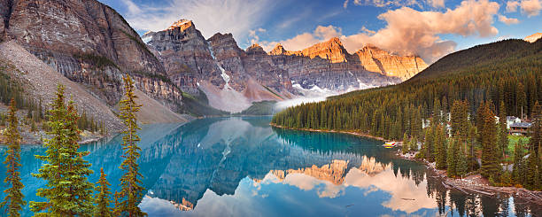 Moraine Lake at sunrise, Banff National Park, Canada Beautiful Moraine Lake in Banff National Park, Canada. Photographed at sunrise. A seamlessly stitched panoramic image. canadian rockies stock pictures, royalty-free photos & images