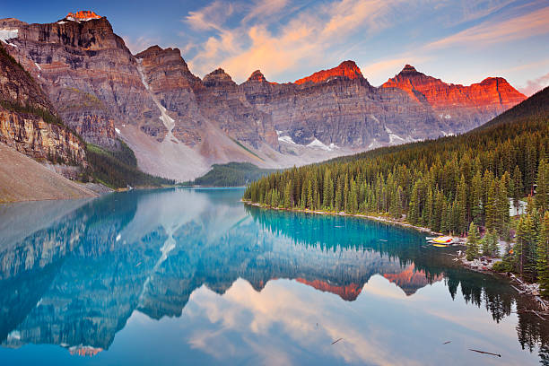 Moraine Lake at sunrise, Banff National Park, Canada Beautiful Moraine Lake in Banff National Park, Canada. Photographed at sunrise. rocky mountains north america stock pictures, royalty-free photos & images