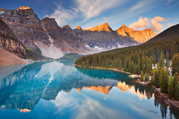 Moraine Lake at sunrise, Banff National Park, Canada Beautiful Moraine Lake in Banff National Park, Canada. Photographed at sunrise. canadian rockies stock pictures, royalty-free photos & images
