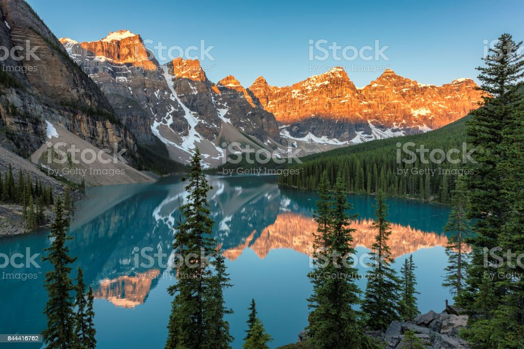 Moraine Lake at sunrise in Banff National Park stock photo