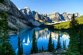 Beautiful Moraine Lake in Alberta, Canada with the mountains reflected in the blue glacial waters.
