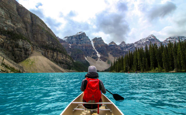 Moraine Lake Clean A new edit from one of my favorite shots - my wife and I canoeing on Moraine Lake in Alberta, Canada. moraine lake stock pictures, royalty-free photos & images